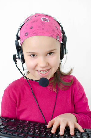 Girl with Desktop computer and headset photo