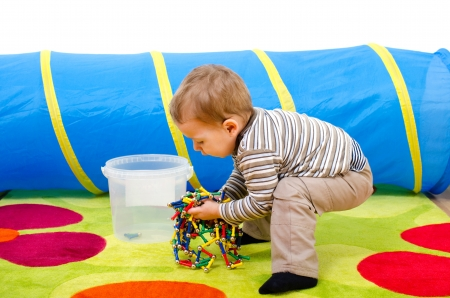 little boy put his toys away Stock Photo