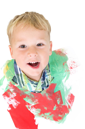 Little boy with paint paper