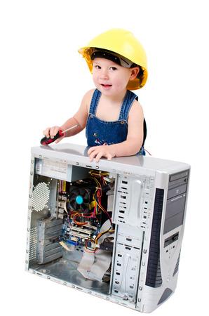 little boy repairing a computer