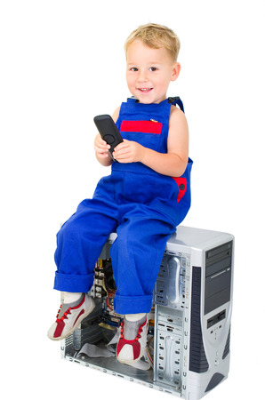 little boy with phone on a computer photo