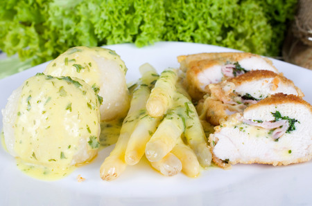 Chicken Cordon Bleu with herb stuffing, fresh German asparagus and potato dumplings photo