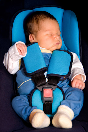 car seat: Infant in a car seat with seat belt