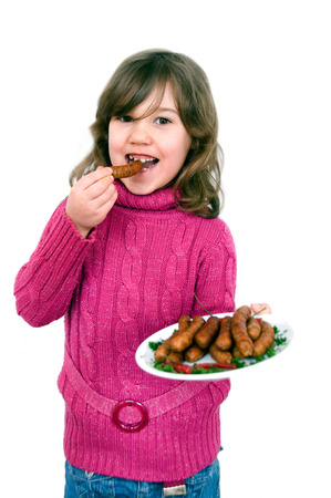 Girl with plate of fried sausages