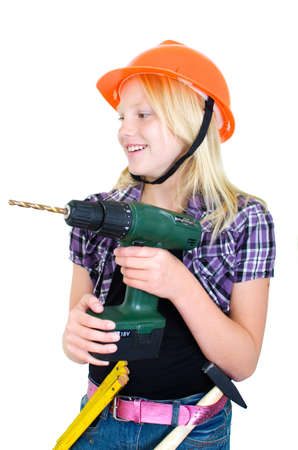 Preteen girl as a craftswoman with drilling machine photo