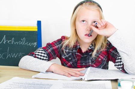 stress testing: preteen girl mulling over your homework Stock Photo