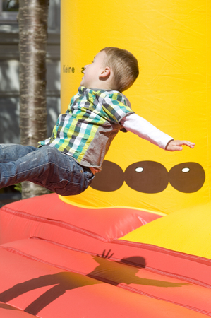 little booy jumping on a bouncy castle photo