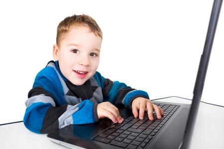 parental control: little boy playing on laptop