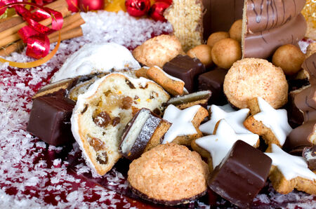 christmassy: Christmassy sweets with studs, macaroons, cinnamon, marzipan and dominoes Stock Photo