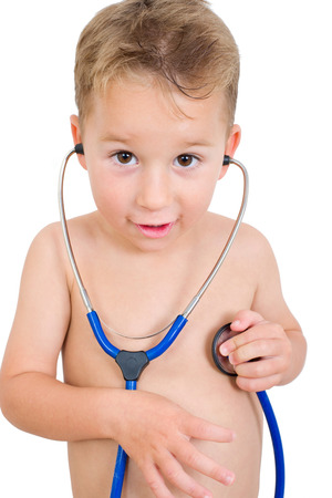 heart sounds: little boy listens to his heart Stock Photo