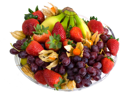 Fruitplate with physalis, bananas, grapes and strawberries