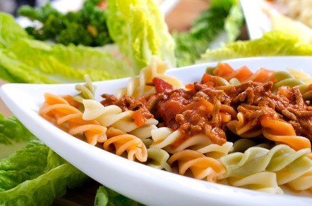 bolognaise: brightly colored Fusilli with bolognaise Stock Photo
