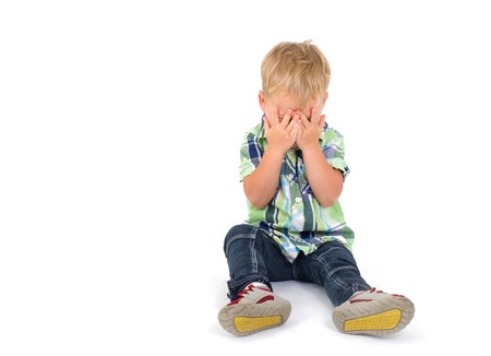 blind child: Little boy closes his eyes with his hands    Stock Photo