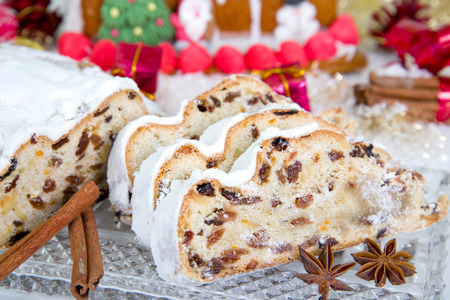 Butter-Mandel-Stollen with marzipan in a Christmas decoration