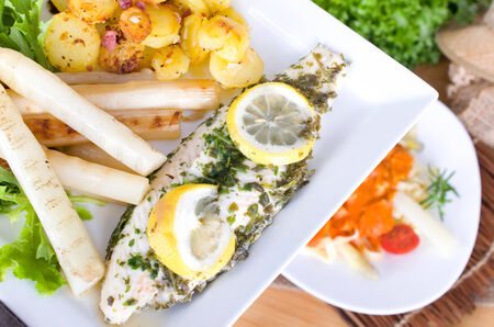 pangasius: Pangasius in herbs with asparagus and roasted potatoes