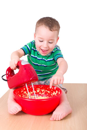 confiscated: Little boy mixes dough with a red mixer