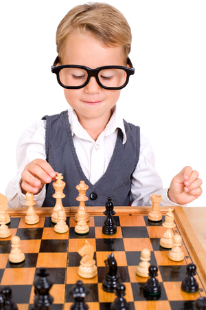 intellectually: less clever boy playing chess