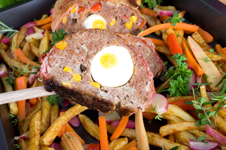 meatloaf: Meatloaf from the oven plate with colorful vegetables