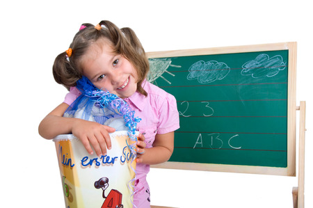 enrollment: little girl with a cornet for enrollment Stock Photo