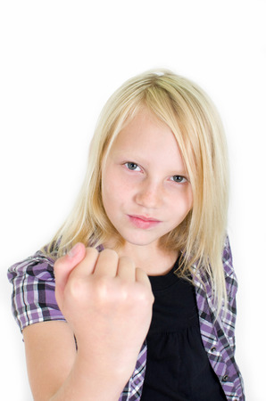 defenses: Young angry girl raises her fist Stock Photo