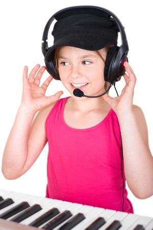 little girl with headphones and keyboard photo