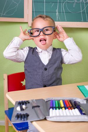 naughty boy: naughty little boy playing school Stock Photo
