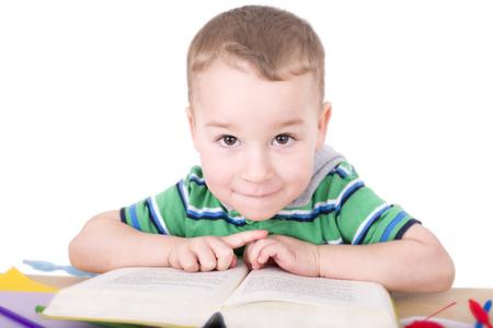 bookish: little boy reading a book