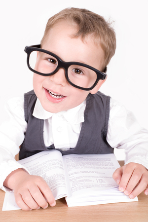 bookish: little boy with a nerd glasses reading a book