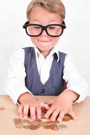 stingy: little nerd holds his money