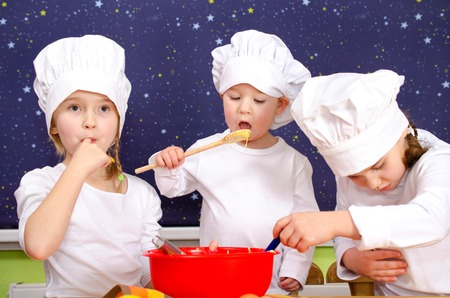 configured: three children baking cakes with fun