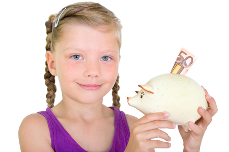 sparingly: Girl with piggy bank and 50 euro