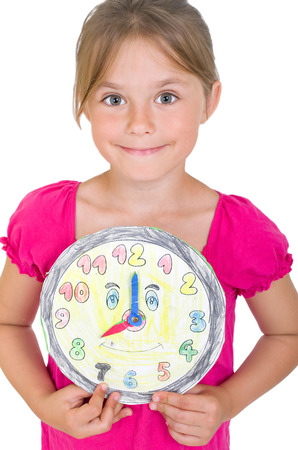 self made: young girl with a homemade clock Stock Photo