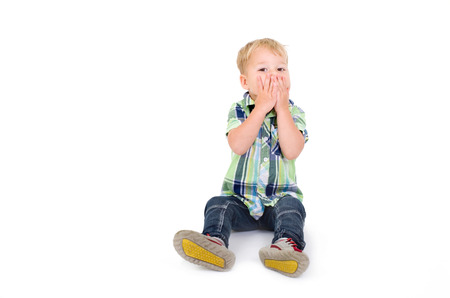 softly: little boy holding his mouth Stock Photo