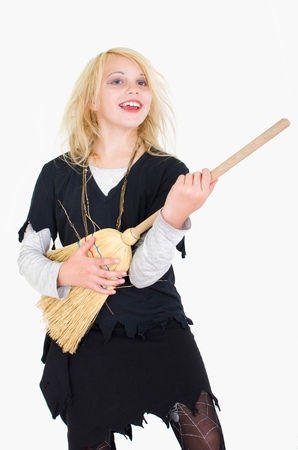 air guitar: young girl playing air guitar with a broom