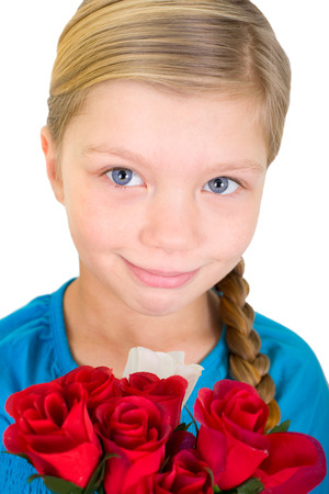 flowerpower: little blond girl with a bouquet of roses Stock Photo