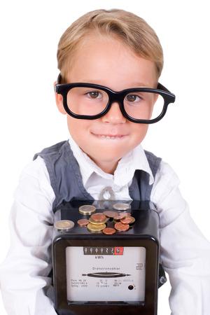 Kleiner Junge mit Stromzähler und Geld Standard-Bild - 35373176