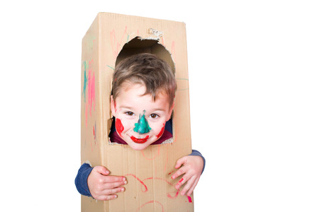 imaginative: little boy playing with a cardboard box