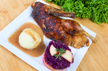 red cabbage: halved roasted duck with potato dumplings and red cabbage Stock Photo