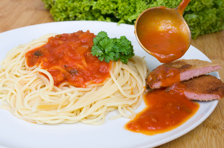 ddr: Spaghetti with tomato sauce and Escalope chasseur Stock Photo