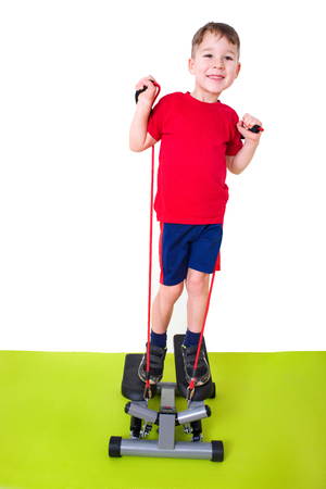 step up: little boy makes gymnastics wiith a step up