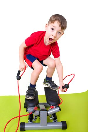 step up: Boy makes Sport with a step up Stock Photo