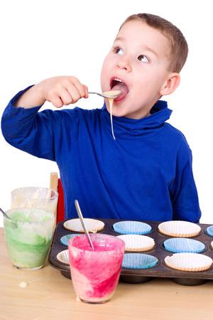 tastes: little boy tastes from muffin