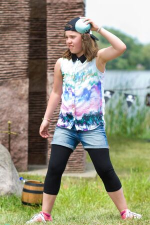 Girl at ball impact on the lake Zdjęcie Seryjne