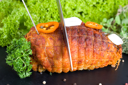 stuffing: Putenrollbraten mit Paprikaf�llung auf einer Schieferplatte  Rolled turkey joint with chili stuffing Stock Photo