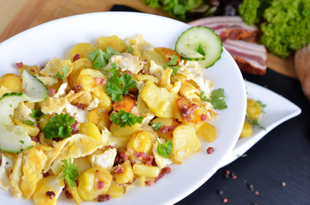 scrambled eggs: Farmers breakfast, scrambled eggs with fried potatoes, onions and bacon