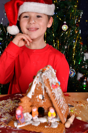 builds: little boy builds a house of gingerbread Stock Photo