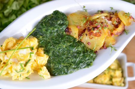 creamed: Spinach with scrambled eggs and fried potatoes