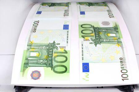 fake money: 100 euro bills fresh from the printer Stock Photo