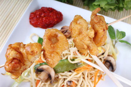 tans: fried noodles with fried chicken in batter