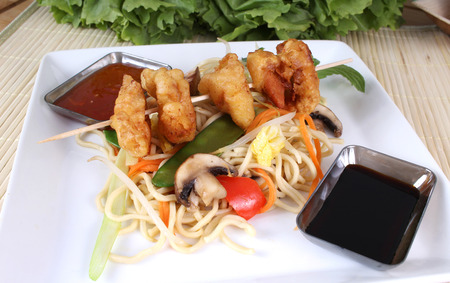 tans: Asian noodle dish with fried wontons with different sauces